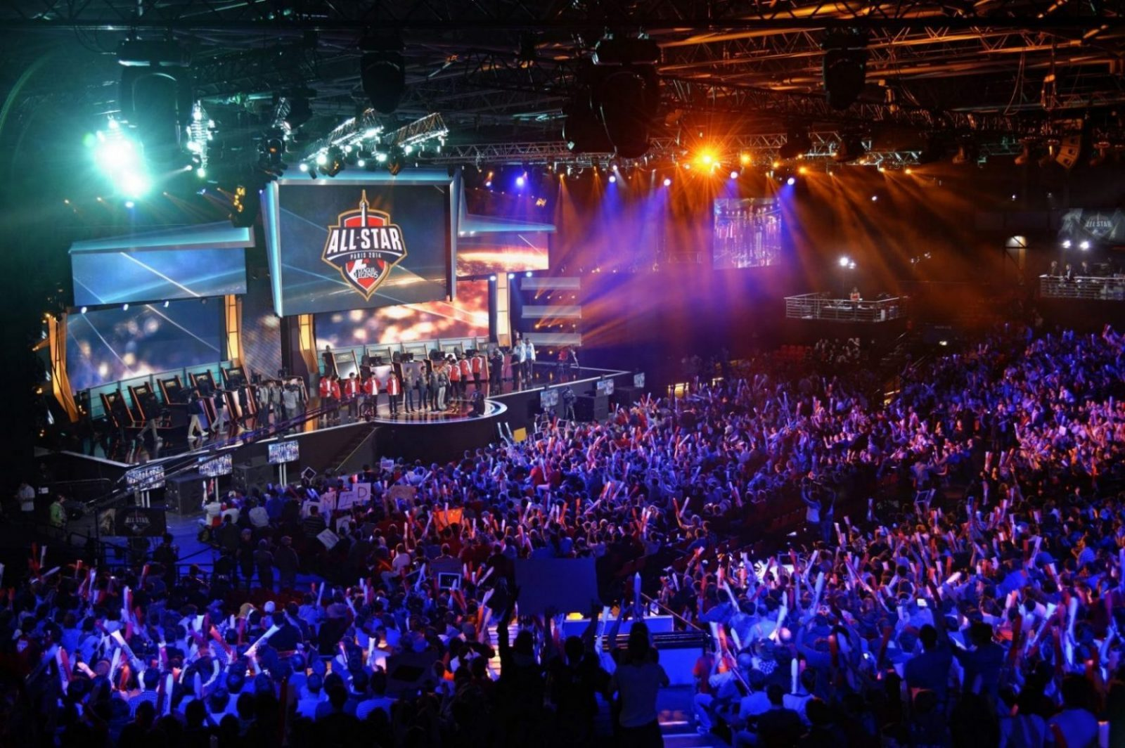 "Visitors cheer for international teams during the tournament of the computer game ""League of Legends"" on May 8, 2014 in Paris. Launched late in 2009 by American video game publisher Riot Games, ""League of Legends"" is a game in which teams of five players compete in a virtual arena, killing each other using different powers and equipments in the goal to capture the enemy base. According to Riot Games, more than 67 million people play each month, with peaks of more than 7.5 million concurrent players at peak hours. The game will last four days starting today. AFP PHOTO / LIONEL BONAVENTURE        (Photo credit should read LIONEL BONAVENTURE/AFP/Getty Images)"